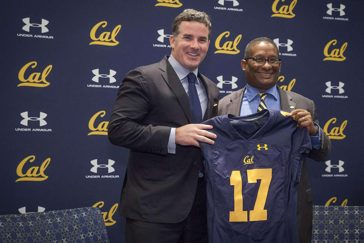 Under Armour CEO Kevin Plank (left) and University of Berkeley Athletics Director Mike Williams hold up a jersey with the number 17, signifying the start of their new 10 year apparel agreement starting on July 01, 2017 to outfit athletes campus wide in UC Berkeley, California, USA 22 Apr 2016. (Peter DaSilva/Special to The Chronicle)
