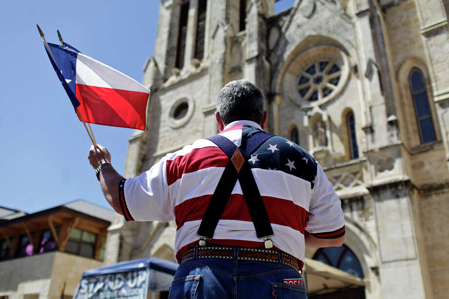 Religious freedom has long been a rallying cry in Texas, but there also exists a right to be free of religion. In 2012, protesters gathered on Main Plaza during the Stand Up for Religious Freedom Rally. Photo: Express-News File Photo / @San Antonio Express-News