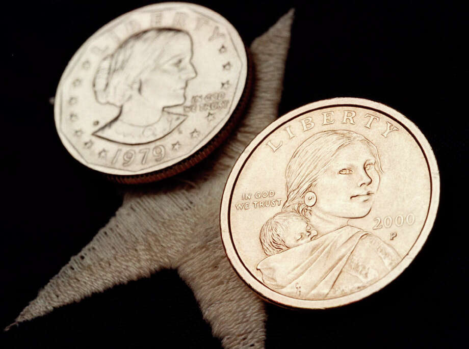 The Sacagawea dollar coin (foreground) and the older Susan B. Anthony dollar coin it replaced failed to catch on with the American public. The Treasury Department announced Wednesday that Harriet Tubman will appear on the $20 bill, but not for a while. This is long overdue and should occur quicker. Photo: Associated Press File Photo / THE HUNTSVILLE TIMES