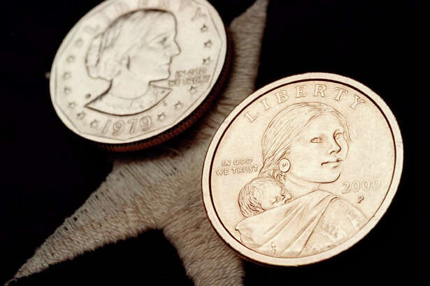 The Sacagawea dollar coin (foreground) and the older Susan B. Anthony dollar coin it replaced failed to catch on with the American public. The Treasury Department announced Wednesday that Harriet Tubman will appear on the $20 bill, but not for a while. This is long overdue and should occur quicker.