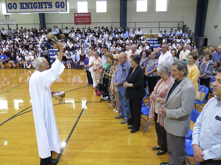 Saint Augustine High School students look on as Father Anthony Mendoza blesses the grandparents who participated in the school's Grandparents Day activities Monday at the school's Wellness Center. The Mass was followed by a brunch at the Alumni Center. Abuelos, grandparents — what we call our parents' parents seems to have to do with ethnicity, national origin and how our kids pronounced things when they were young. Photo: CUATE SANTOS / / LAREDO MORNING TIMES