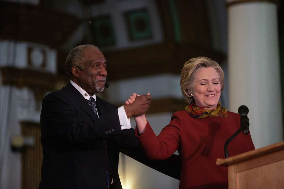 Hillary Clinton is introduced by the Rev. Dr. Johnny Ray Youngblood during a Sunday service at Mount Pisgah Baptist Church in the Brooklyn borough of New York, on April 3. Though Clinton has fiercely campaigned on overhauling the criminal justice system, her husband's remarks to Black Lives Matter demonstrators have ignited a fierce backlash. Photo: VICTOR J BLUE /NYT / NYTNS