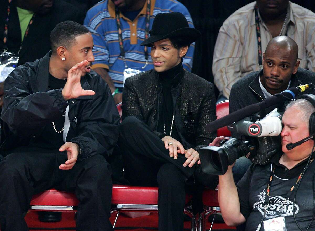 LAS VEGAS - FEBRUARY 18: Rapper Ludacris, musician Prince and actor Dave Chappelle watch the game during the 2007 NBA All Star Game held at the Thomas & Mack Center on February 18, 2007 in Las Vegas, Nevada. (Photo by Ethan Miller/Getty Images)