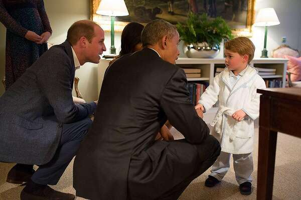 President Barack Obama and First Lady Michelle Obama meet Prince George at Kensington Palace on Friday, April 22, 2016/