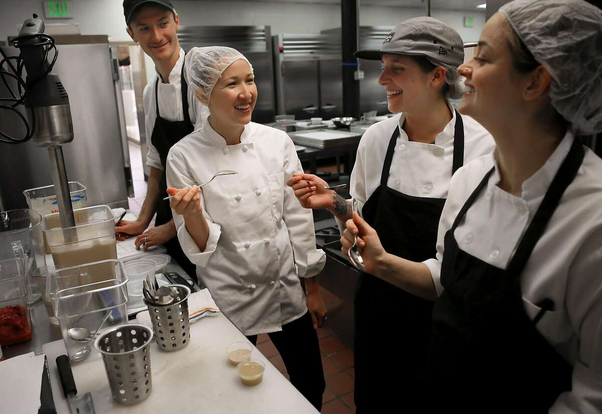 ( l to r) Nick Rose-Rankin, R&D chef, executive R&D chef Jessica Entzel, recipe testers Brooke Ulmer and Jenna Ross test a red wine vinaigrette dressing at Sprig an on-demand food delivery service in San Francisco, California on Thurs. April 21, 2016.