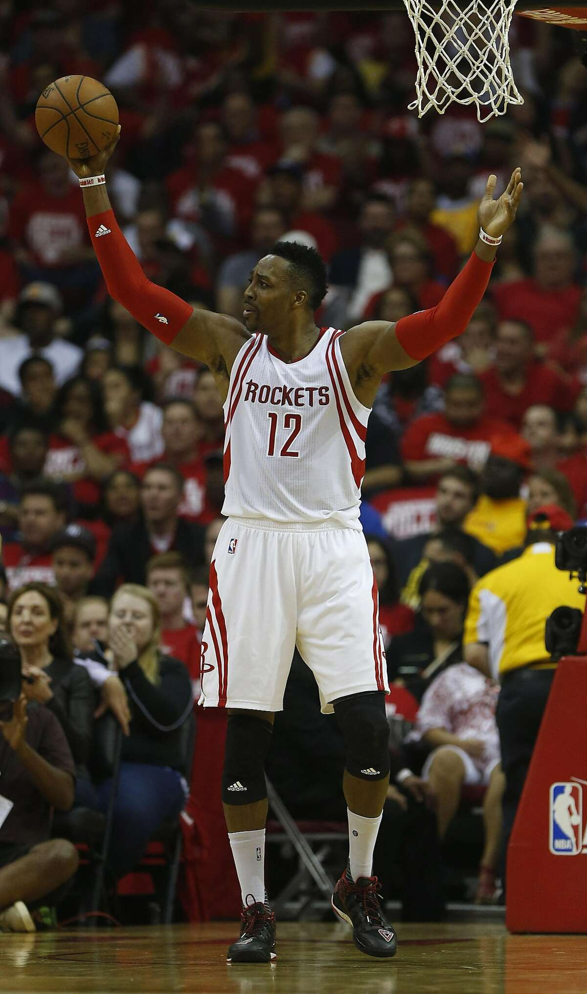Houston Rockets center Dwight Howard (12) reacts after being called for a foul during the first half in game three of a first-round NBA playoffs series at Toyota Center, Thursday, April 21, 2016, in Houston. ( Karen Warren / Houston Chronicle )