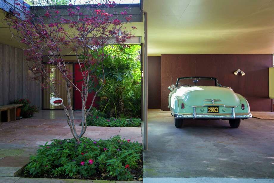 A 1950 Chevy parked in front of the house - inherited from Martha Curry's father - makes it feel as though this mid-century house is a time capsule. Photo: Marie D. De Jesus, Staff / © 2016 Houston Chronicle