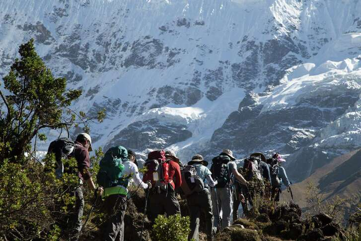 Houston trekkers make their way to Salkantay Pass, the highest point of their trip, at 15,213 feet.