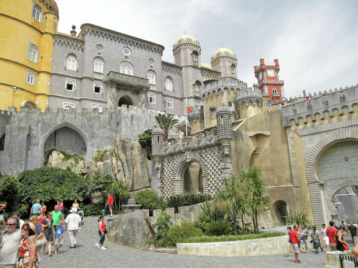 Everything about Pena Palace in Portugal is fantastical, starting with its ersatz moat and drawbridge.
