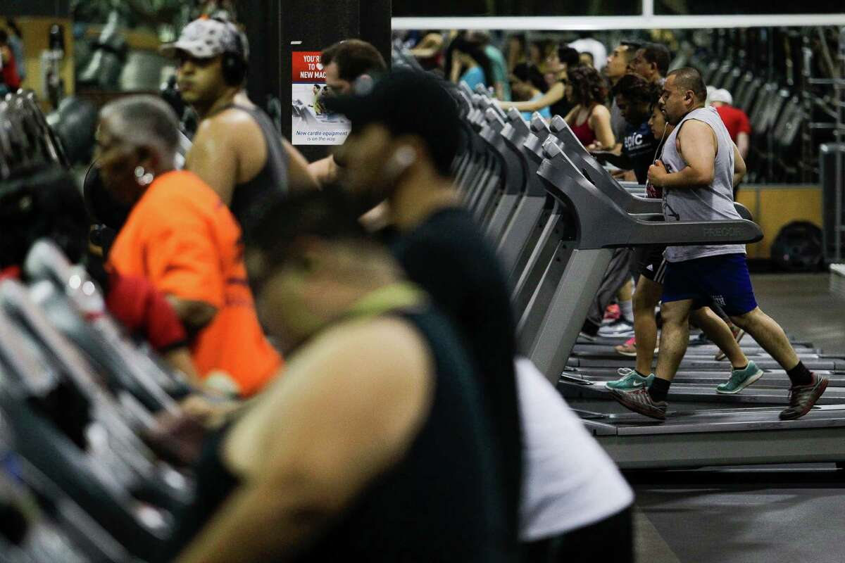 Abdul Naser, right, runs on a treadmill at 24 Hour Fitness at nine p.m. Tuesday, April 12, 2016 in Houston. ( Michael Ciaglo / Houston Chronicle )