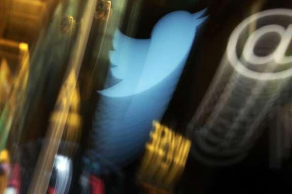 FILE - In this Wednesday Nov. 6, 2013, file photo, the Twitter logo appears on an updated phone post on the floor of the New York Stock Exchange. Twitter reports financial results Friday, April 22, 2016. (AP Photo/Richard Drew, File)