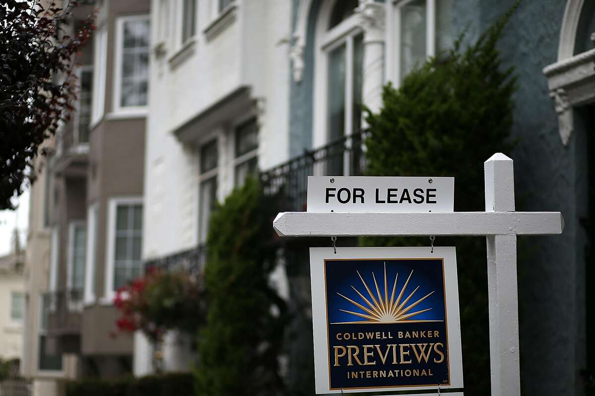 A for lease sign is posted in front of home for rent in San Francisco.