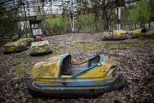 CHERNOBYL, UKRAINE - APRIL 22: Cars of the children autodrome are seen in the abandoned city of Pripyat, Ukraine, April 22, 2016. The world will mark the thirtieth anniversary of the Chernobyl nuclear disaster on April 26, 2016.