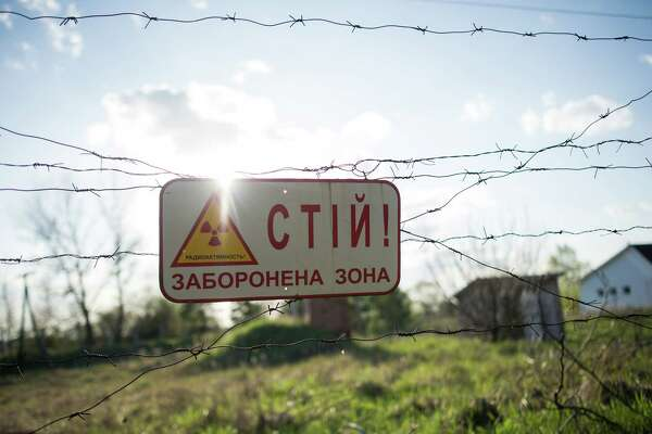 "CHERNOBYL, UKRAINE - APRIL 22: A sign saying ""Stop! Forbidden Zone"" is seen on the fence of Chernobyl Exclusion Zone, Chernobyl, Ukraine, April 22, 2016. The world will mark the thirtieth anniversary of the Chernobyl nuclear disaster on April 26, 2016."