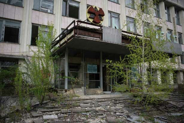 CHERNOBYL, UKRAINE - APRIL 22: A building with a radiation sign is seen in the abandoned city of Pripyat, Ukraine, April 22, 2016. The world will mark the thirtieth anniversary of the Chernobyl nuclear disaster on April 26, 2016.