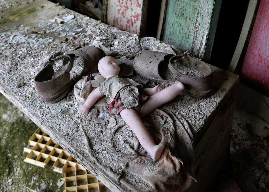 "Photos: Chernobyl, 30 years laterA doll and shoes lay on a bench in a nursery school of the ""ghost town"" of Pripyat near the Chernobyl Nuclear Power Plant on April 22, 2016.