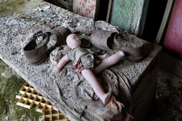 "A doll and shoes lay on a bench in a nursery school of the ""ghost town"" of Pripyat near the Chernobyl Nuclear Power Plant on April 22, 2016. April 26, 2016 marks the 30th anniversary of the Chernobyl nuclear disaster.  / AFP / GENYA SAVILOV"