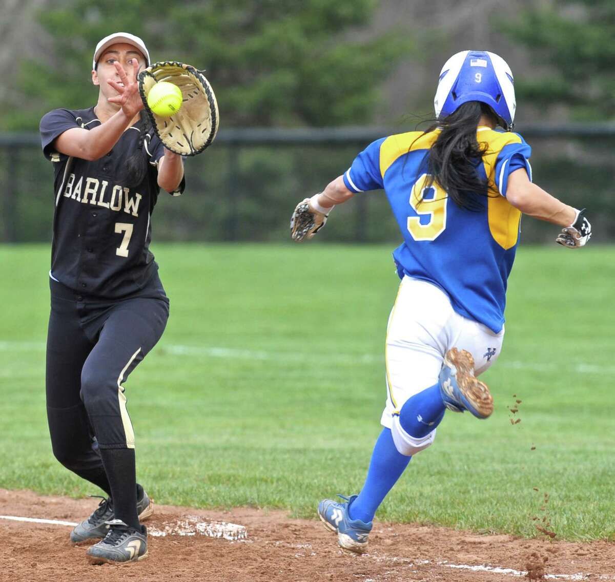 Joel Barlow's Zoe Marcelino (7) makes the catch for the put out on Newtown's Haley Ryan (9) in the SWC softball game between Newtown and Joel Barlow high schools on Friday afternoon, April 22, 2016, at Joel Barlow High School, in Redding, Conn.