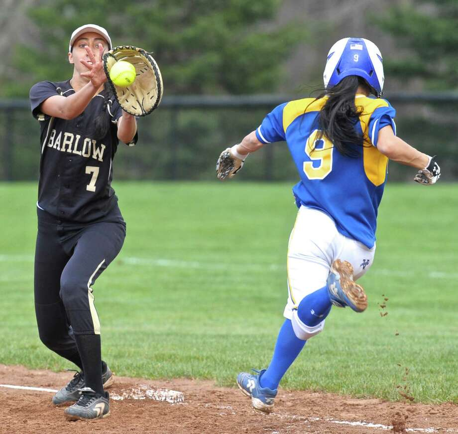Joel Barlow's Zoe Marcelino (7) makes the catch for the put out on Newtown's Haley Ryan (9) in the SWC softball game between Newtown and Joel Barlow high schools on Friday afternoon, April 22, 2016, at Joel Barlow High School, in Redding, Conn. Photo: H John Voorhees III / Hearst Connecticut Media / The News-Times