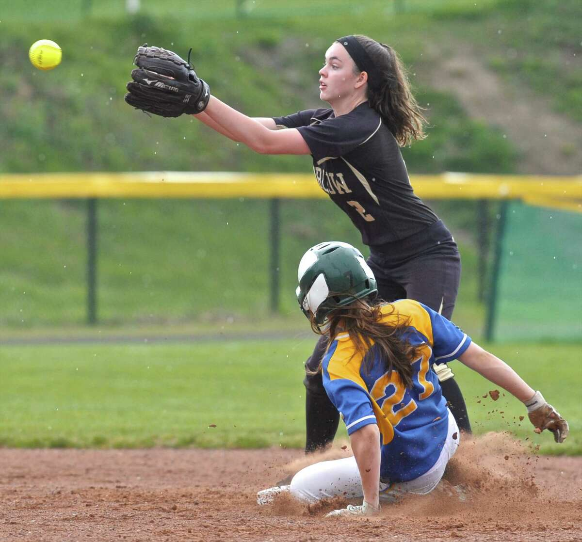 Newtown's Mackenzie Macchiarulo (27) slides safely into second base as Joel Barlow's Scotland Davis (2) reaches for the ball in the SWC softball game between Newtown and Joel Barlow high schools on Friday afternoon, April 22, 2016, at Joel Barlow High School, in Redding, Conn.