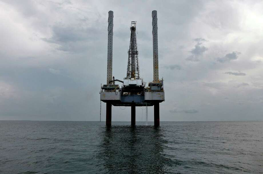 A Hercules Offshore Inc. jackup shallow-water drilling unit stands idle in the Gulf of Mexico off the coast of Cameron, Louisiana, U.S., in July 2010, after the federal government imposed a deepwater drilling moratorium and slowed new shallow water permits in the wake of the BP Deepwater Horizon oil spill. Photographer: Aaron M. Sprecher/Bloomberg Photo: Aaron M. Sprecher, 705035