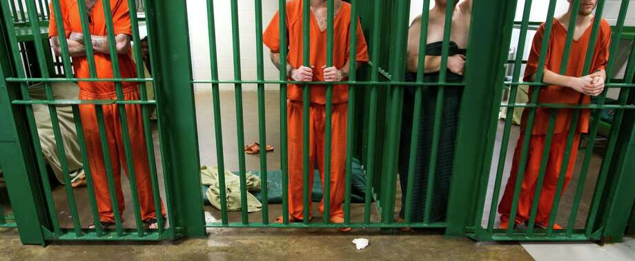 Inmates stands behind bars in one of the mental health pods at the Harris County Jail Wednesday, April 13, 2011, in Houston. ( Brett Coomer / Houston Chronicle ) Photo: Brett Coomer, Staff / Houston Chronicle