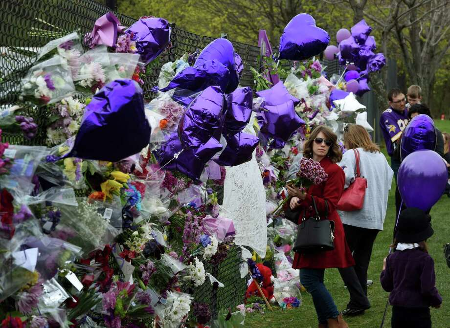 Prince fans pay their respects outside his Paisley Park compound in Minneapolis on Friday. His death on Thursday followed canceled shows and a reported emergency medical landing.     Photo: MARK RALSTON, Staff / AFP or licensors
