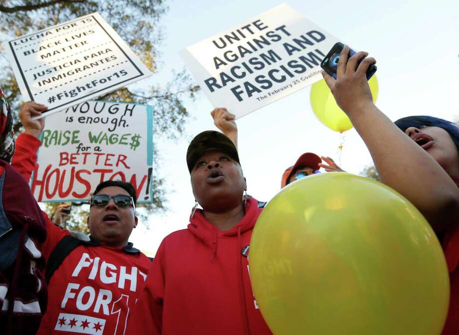 Freda Lacy, a 32-year-old fast food worker from Austin, protests for an increase in the minimum wage and for the formation of a union, before the Republican presidential debate at the University of Houston Thursday, Feb. 25, 2016, in Houston. ( Jon Shapley / Houston Chronicle ) Photo: Jon Shapley, Staff / © 2015  Houston Chronicle