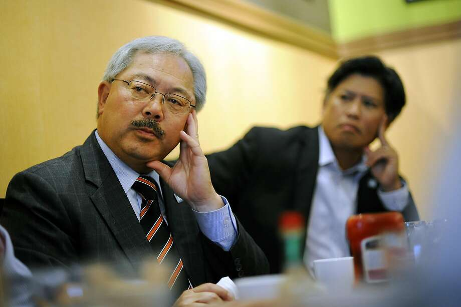 Mayor Ed Lee, left, sits next to Eric Tao, right, and others during an affordable housing meeting at Sam's Diner in San Francisco, CA Monday, September 28, 2015. Photo: Michael Short, Special To The Chronicle