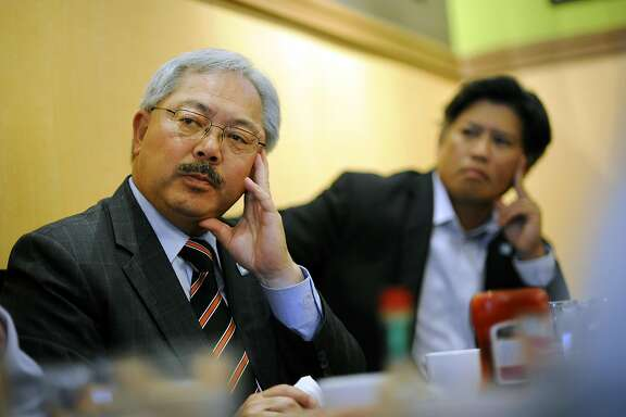 Mayor Ed Lee, left, sits next to Eric Tao, right, and others during an affordable housing meeting at Sam's Diner in San Francisco, CA Monday, September 28, 2015.