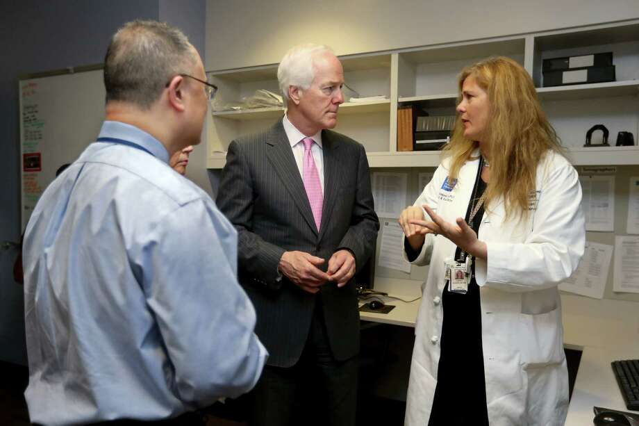 Sen. John Cornyn, center, met with doctors and public health officials Friday at Texas Children's Hospital, including Dr. Wesley Lee, division director of women's and fetal imaging, and Dr. Kjersti Aagaard, vice chair of research and associated professor of obstetrics and gynecology. Photo: Gary Coronado, Staff / © 2015 Houston Chronicle