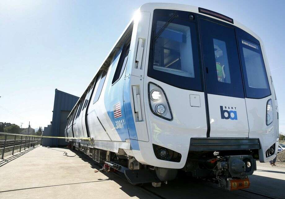 BART unveils the first of the transit agency's new fleet of 775 cars at the testing facility in Hayward, Calif. on Wednesday, April 6, 2016. A train ran into dirt at the facility Friday and sustained minor damage.