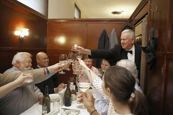 Long time patrons from Newport Asia LLC toast waiter Giovanni Sodini (top right) who retires after working at Sam's Grill for fourty five years in San Francisco, California on friday, april 22, 2016.