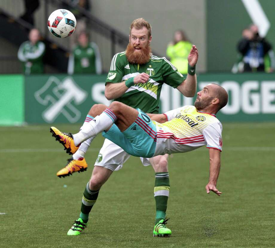 Forward Federico Higuain, scoring on a bicycle kick against Portland earlier this season, is the point man in Columbus' offensive attack. Photo: Steve Dipaola, FRE / FR170491 AP