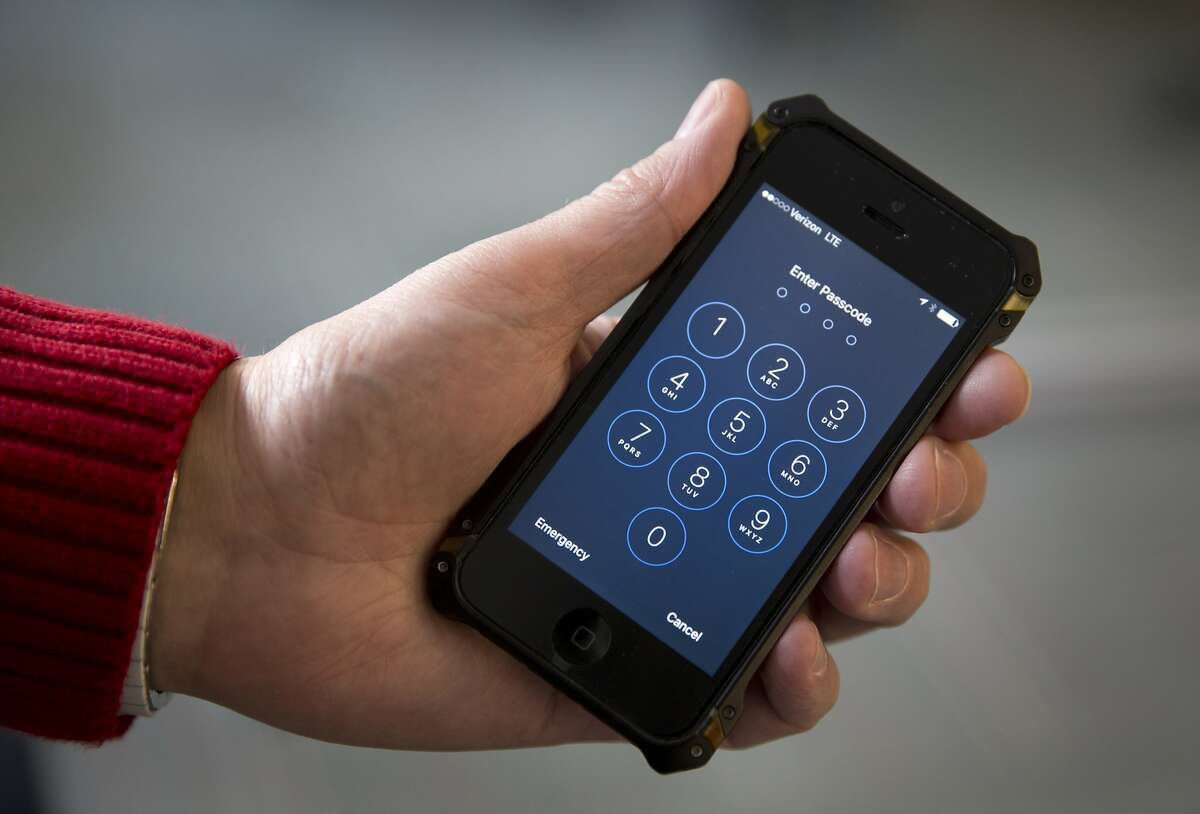 FILE - In this Feb. 17, 2016 file photo an iPhone is seen in Washington. FBI Director James Comey hinted at an event in London on Thursday, April 21, 2016, that the FBI paid more than $1 million to break into the locked iPhone used by one of the San Bernardino attackers. (AP Photo/Carolyn Kaster, File)