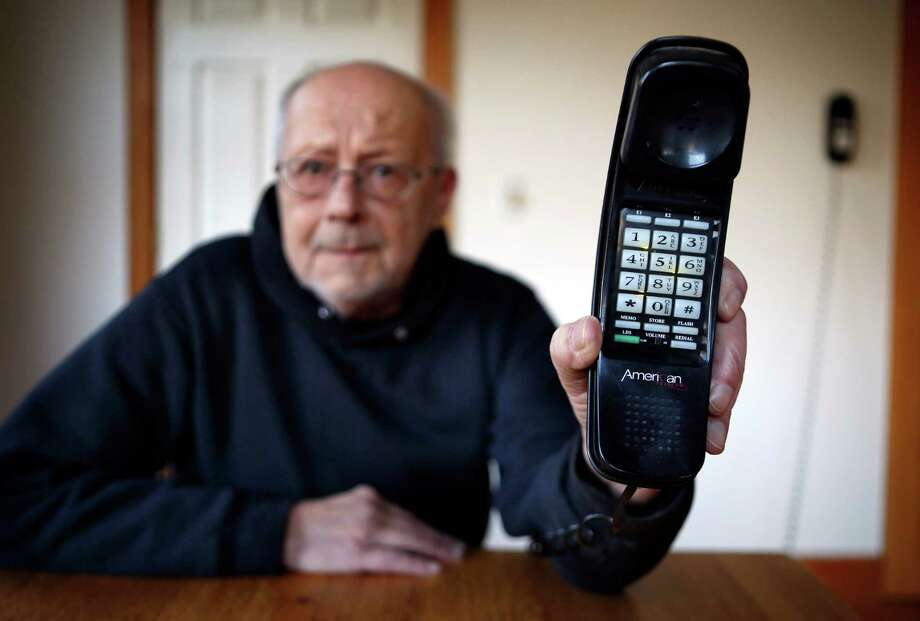 Peter Froehlich depends on a landline telephone because he lives in a wireless dead zone. He's concerned about a new Maine law that phases out the requirement for telephone companies to provide landline service. Photo: Robert F. Bukaty, STF