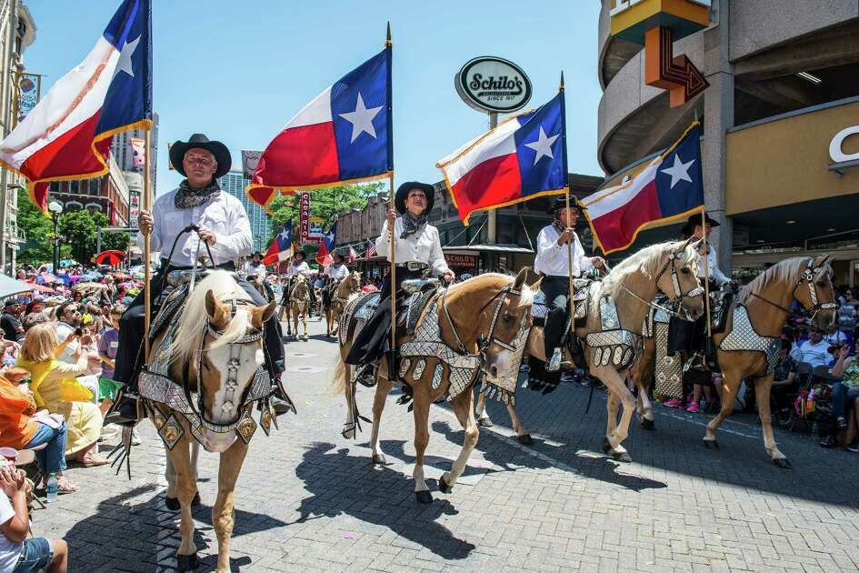 The Battle of Flowers marching parade makes its way down Commerce Street in San Antonio, Texas on Friday, April 22, 2016.