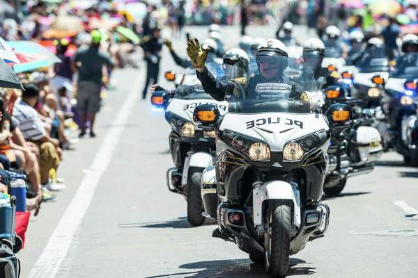 San Antonio Police Officers drive their motorcycles during the Battle of Flowers parade in San Antonio, Texas on Friday, April 22, 2016.