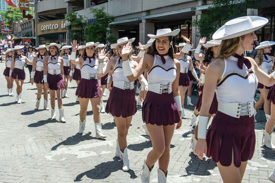 Members of the Texas State Strutters march during the Battle of Flowers parade in San Antonio, Texas on Friday, April 22, 2016. Photo: Matthew Busch, Stringer / For The San Antonio Express-News / © Matthew Busch