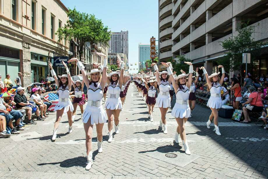 Members of the Texas State Strutters, the drill team for Texas State University in San Marcos, march during the Battle of Flowers parade Friday in San Antonio. Photo: Matthew Busch, Stringer / © Matthew Busch