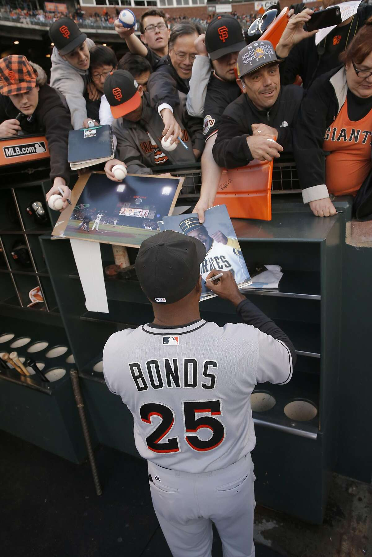 Former San Francisco Giants' slugger Barry Bonds, signing autographs for fans, is now the hitting coach for the Florida Marlins returns to AT&T Park in a major league uniform for the first time since August of 1992, on Fri. April 22, 2016, in San Francisco, California.