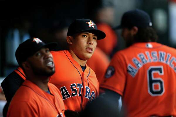 Houston Astros third baseman Luis Valbuena (18), Houston Astros shortstop Carlos Correa (1) and Houston Astros left fielder Jake Marisnick (6) before the start of a game agains the Boston Red Sox at Minute Maid Park Friday, April 22, 2016, in Houston, Texas.
