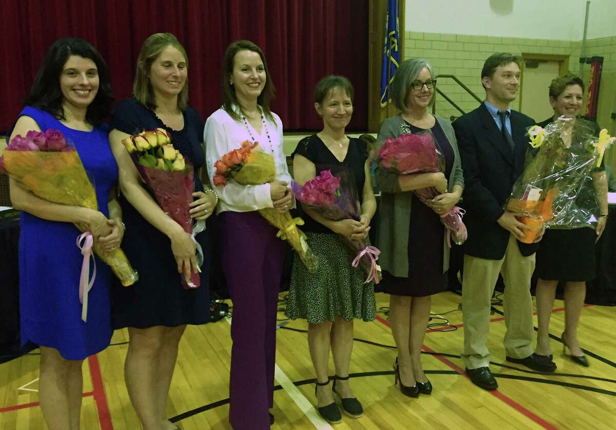 The Greenwich school district's 2016 Distinguished Teachers were recognized at a Board of Education meeting Thursday, April 21, 2016 at Riverside School. From left, are: Ana Chejin-Danielsen, Julie Cofone, Sarah Goldin, Sarah Harris, Jeannine Madoff and Ian Tiedemann. At far right is Sue Rogers, chairwoman of the Distinguished Teachers Awards Committee.