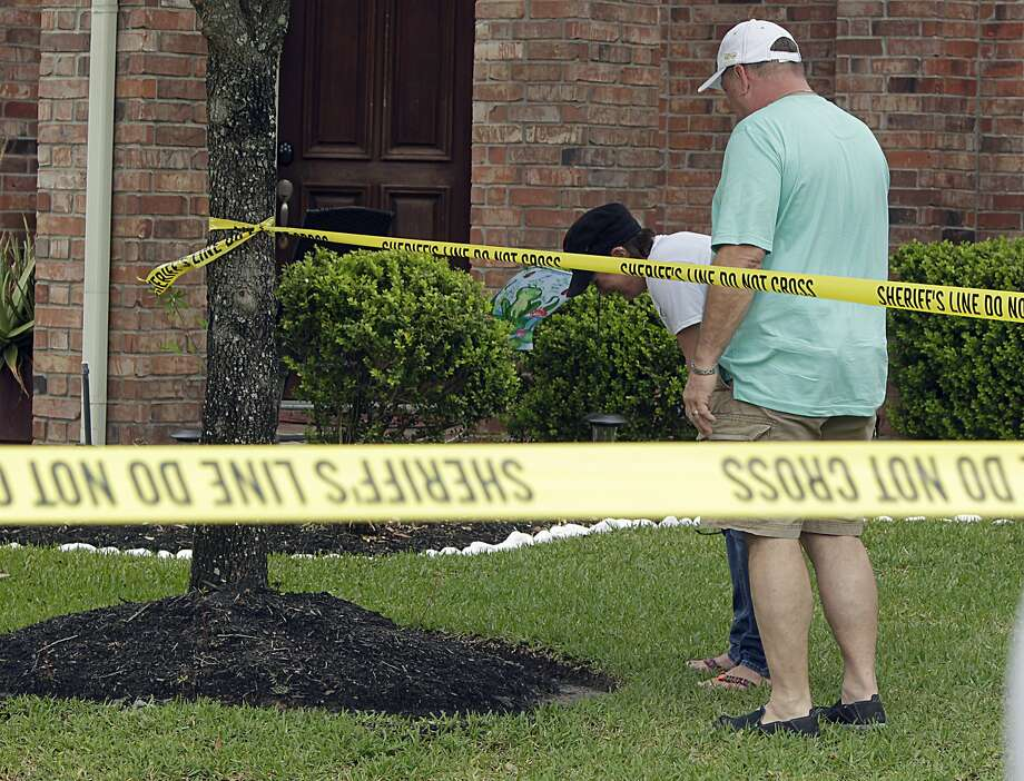 A couple break down in tears as authorities investigate a murder-suicide involving their friends in Katy, Texas. The national suicide rate climbed 24 percent between 1999 and 2014, the U.S. Centers for Disease Control and Prevention says. Photo: James Nielsen, Houston Chronicle