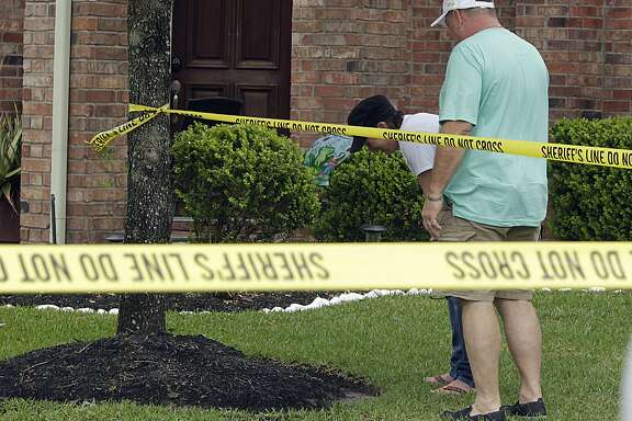 Tracy  Dugal left, breaks down in tears with her husband Thomas Dugal as Fort Bend County Sheriff Deputies investigate a murder suicide involving 2 adults and two children at a home in the 1300 block of Longdraw involving friends of the Dugal'sTuesday, April 19, 2016, in Katy. ( James Nielsen / Houston Chronicle )