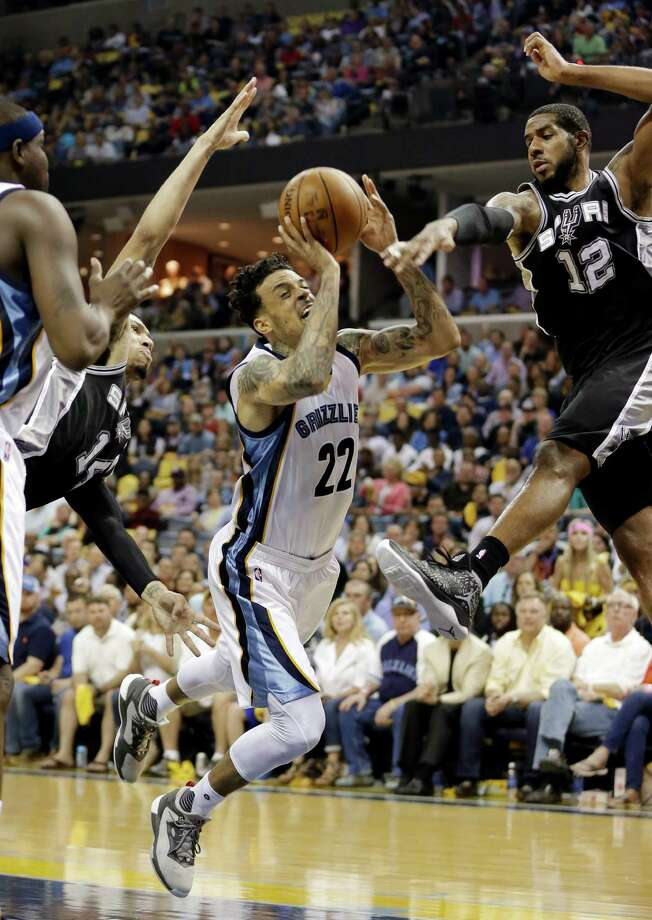 Memphis Grizzlies forward Matt Barnes (22) drives between San Antonio Spurs defenders Danny Green (14) and LaMarcus Aldridge (12) in the first half of Game 3 of a first-round NBA basketball playoff series Friday, April 22, 2016, in Memphis, Tenn. (AP Photo/Mark Humphrey) Photo: Mark Humphrey, Associated Press / Copyright 2016 The Associated Press. All rights reserved. This material may not be published, broadcast, rewritten or redistribu
