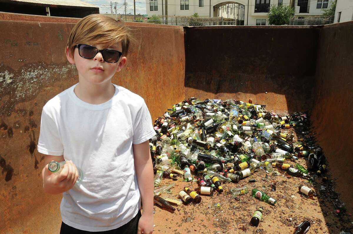Pan Berlanga displays some of the glass he has collected. Pan's parents say they make sure that the business does not keep him from enjoying the normal activities that an 8-year-old enjoys.