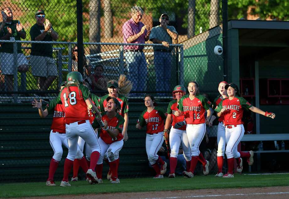 The Woodlands Lady Highlanders celebrate after Emily Langkamp scores a run during a game against the Kingwood Mustangs at The Woodlands High School, Friday, April 22, 2016, in The Woodlands. Photo: Jon Shapley, Houston Chronicle / © 2015  Houston Chronicle