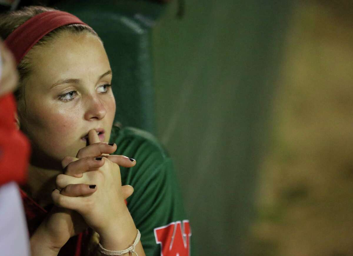 Emily Langkamp, pitcher, watches game action during the sixth inning as the Woodlands High School Lady Highlanders play the Kingwood Mustangs at The Woodlands High School, Friday, April 22, 2016, in The Woodlands.