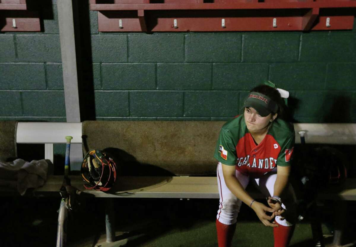 Leah Starkweather, leftfielder, sits quietly in the dugout after a 13-4 loss to the Kingwood Mustangs, at The Woodlands High School, Friday, April 22, 2016, in The Woodlands.